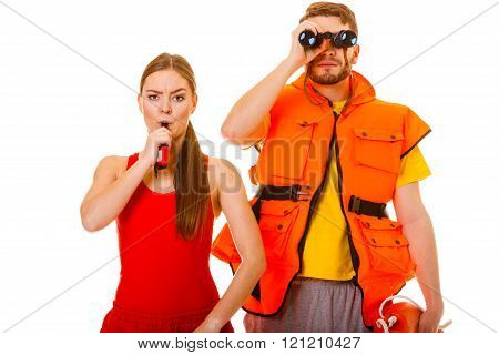 Lifeguards In Life Vest Whistling.