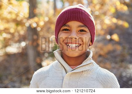 Portrait Of Boy Playing In Autumn Woods