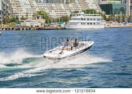Toronto, Ontario, downtown, Aug.15, 2015, nice gorgeous amazing view of people driving motor boat on the lake Ontario at high speed on summer beautiful day