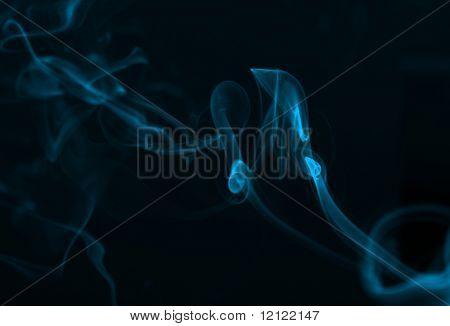 Blue smoke against a black background