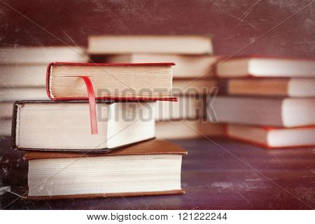 Heap of old books on table, close-up