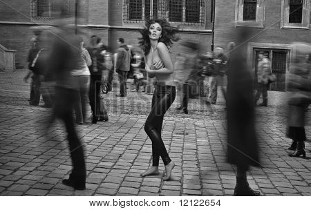Fine art photo - topless brunette startled in the street crowd
