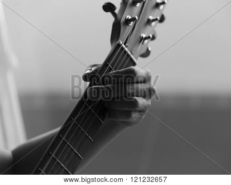Unidentified Male Play Guitar With Left Arm Closeup  Black And White