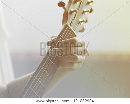 Unidentified Male Play Guitar With Left Arm Closeup With Sunlight Orange Light