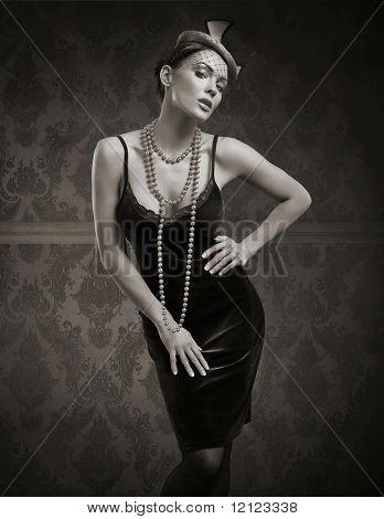 Vogue style vintage portrait in the dim light