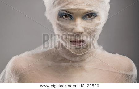 Woman with bandage wrapped around face