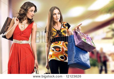 Two young girls in a shopping center