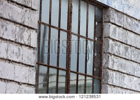 Rusty Metal Window and white birck wall