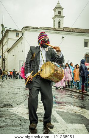 Quito, Ecuador - August 27, 2015: Man with indigenous drum during mass demonstrations against govern