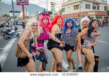 Quito, Ecuador - January 26, 2015: Five guys dreessed with womans clothes celebrating new yearsdurin