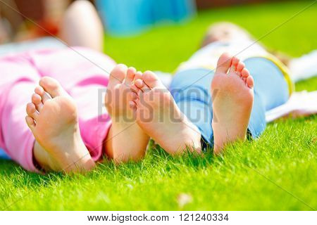 Girl foot on green grass