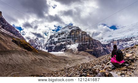 Woman Hiker enjoying the View of Mount Lefroy and Mount Victoria from the trail to the Plain of Six Glaciers in Banff National Park in the Canadian Rockies