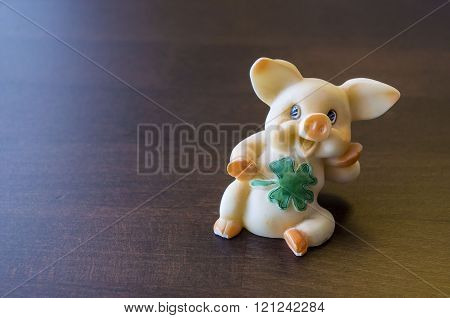 Funny pig with leaf.