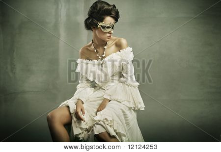 Fine art photo of a young woman wearing mask