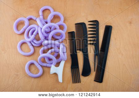 Hairdressing Curlers, Comb, Brushes And Spins On The Table
