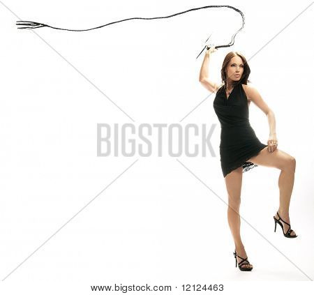 Dominant sexy lady holding a whip, isolated on white