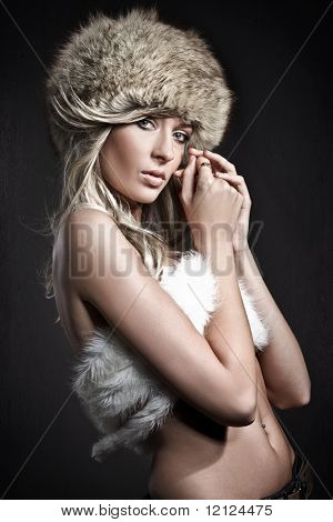 Stunning blonde beauty over dark studio background