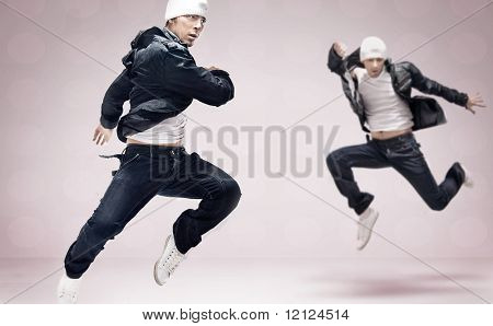 Abstract studio photo of two hip hop dancers