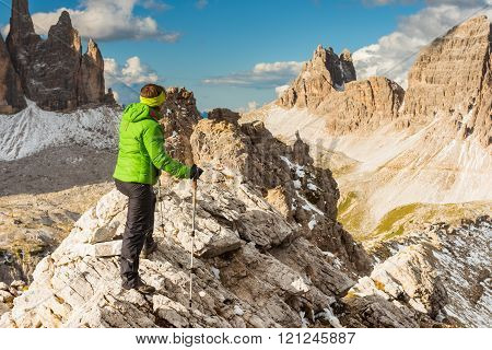 Hiker Enjoying View From Top Of Mountain