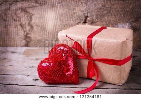 Festive Gift Box  And Decorative Red  Heart On  Vintage  Wooden Background.