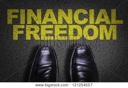 Top View of Business Shoes on the floor with the text: Financial Freedom
