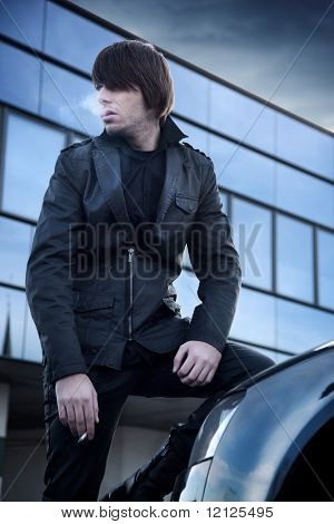 Fashion style photo of a handsome guy smoking