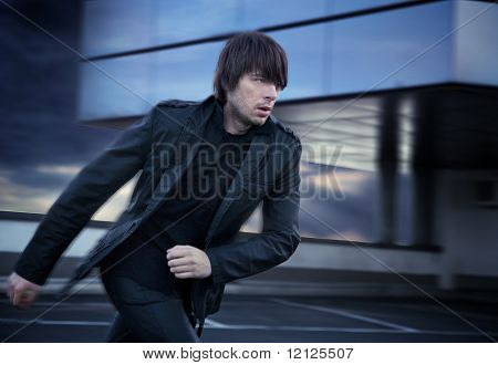 Elegant handsome man running