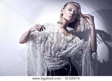 Vogue style photo of a blond beauty