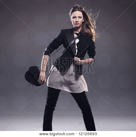 Elegant lady holding handbag, plenty of copyspace