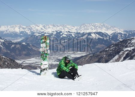 Young Man Have A Rest On The Ski Slope.