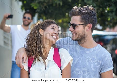 Hip couple looking at each other on the street