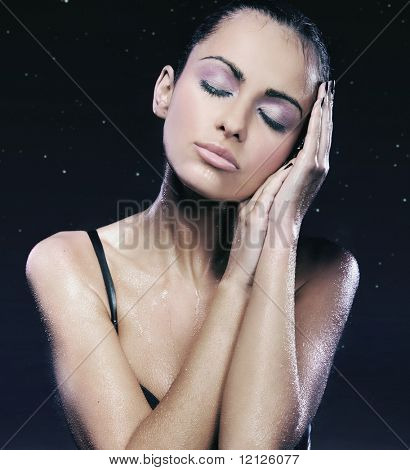 Portrait of a relaxed lady over starry sky