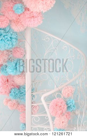 White Spiral Staircase Is Decorated With Pompons.