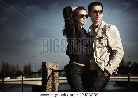 Attractive young couple wearing sunglasses
