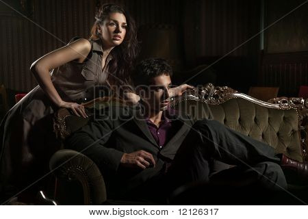 Fashion style photo of an attractive pair posing