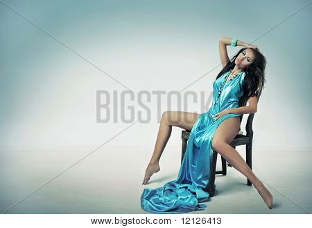 Young lady posing over studio background