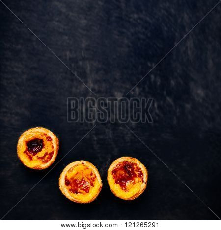 Pasteis De Nata, Typical Portuguese Egg Tart Over Black Background With Blank Copy Space