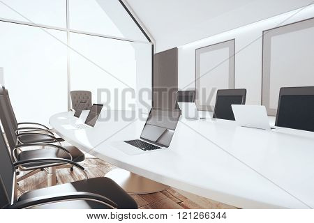 Luxury Conference Room With White Oval Table, Laptops And Blank Pictures, 3D Render, Mock Up