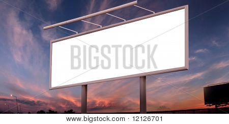 Blank big billboard over sunset sky