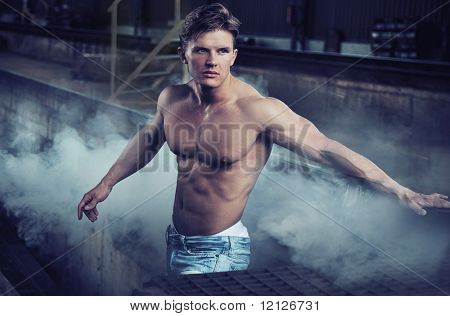 Handsome bodybuilder wearing jeans