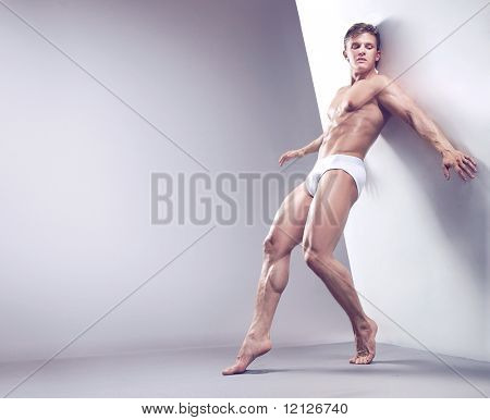 Handsome muscular guy in the studio