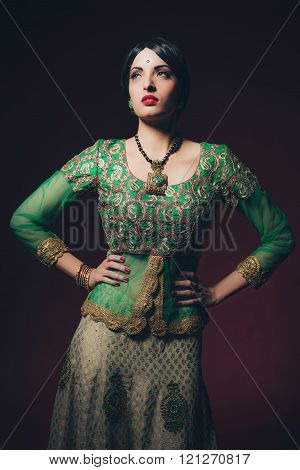 Traditional Vintage Bollywood Fashion Girl Against Dark Red Background.