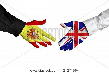 Spain and United Kingdom leaders shaking hands on a deal agreement
