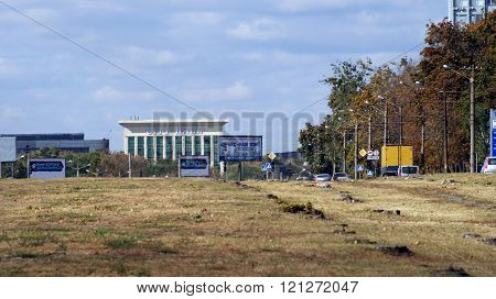 KHARKOV, UKRAINE - CIRCA OCTOBER 2015: The billboards in the background of wasteland and a business center.