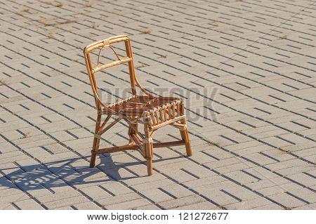 Handmade wicker chair for kids on a street
