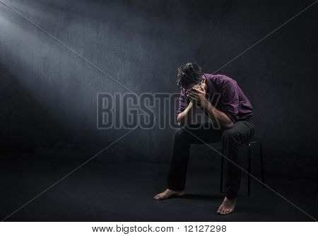 Sad man in a empty room