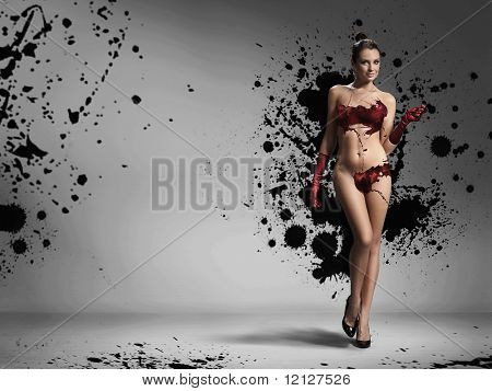 Naked woman wearing gloves