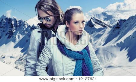 Fashionable couple over alpine mountains