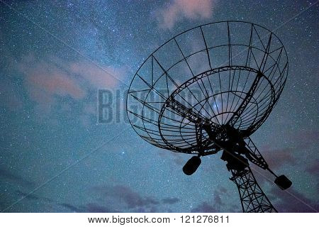huge radar system in colorful sky