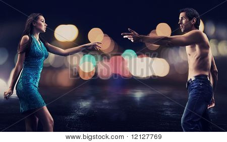 Gorgeous couple over night city street background